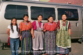 Many schoolgirls in Almolonga-like these high school students--still wear traje, though jeans and teeshirts are also in view.  Lidia Sanchez (right) wears a Patzún-style, while two of her sisters wear a recently popular style handwoven in Almolonga. Photo by Cheryl Guerrero 2005.