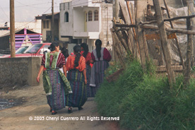 The traje in the department of Quetzaltenango includes an apron, often with lace edges, a jaspe or ikat skirt, and a hand woven huipil in a style specific to the community.  Photo by Cheryl Guerrero 2005.