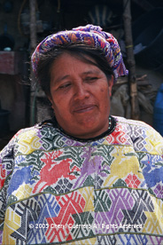 "Unique traje or clothing is still in evidence outside of ""Xela"" or Quetzaltenango, the second largest city in Guatemala.  This Concepción woman both sells and wears her back strap weavings, and has taught all her daughters to do the same.  Photo by Cheryl Guerrero 2005."