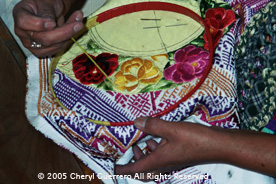 Embroidery, both by hand and machine, is popular throughout the highlands.  This hand embroidery is from the Guipil de Nebáj workshop in San Juan Ostuncalco.  Photo by Cheryl Guerrero 2005.