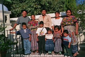 Driver and guide Fernando Pichiyà (left) is pictured with his extended family from Patzicía.  Photo by Cheryl Guerrero 2005.