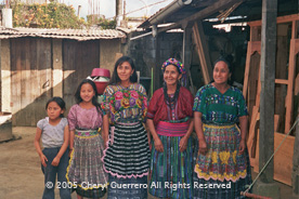 Matron Patrona Pichiyà, Patzicía, has taught both her daughters, Pilar and Santa, to weave on a backstrap loom.  They, however, often choose to weave and wear styles of other communities. Photo by Cheryl Guerrero 2005.