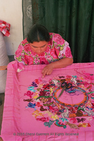 The rural areas around San Andrés Xecul are know for the women's imaginative embroidery, often with colorful animals. Here Vicenta Lucia Hernandes Paxtor works on her Easter huipil. Photo by Cheryl Guerrero 2005.