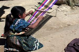 María Eugenia Lopez, 9, proudly worked on her second weaving sampler in the family compound.  Photo by Kathleen Mossman Vitale 2005.