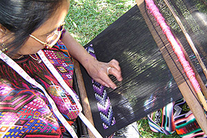 María Tol Perez, who lives in Quejel, Chichicastenango, weaves a textile that will be used to make  Maya Traditions artisan products for export.  María travels to Panajachel occasionally for training in the group's compound in Panajachel.  Photo by Denise Gallinetti 2005.