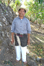 Vicente 'Chema' Queche, 80, works as a gardener on a steep slope in Panajachel.  He wears the rodillera still worn by some older Maya men in the Sololá department.  It is woven on a back strap loom of handspun wool.  Photo by Denise Gallinetti 2005.