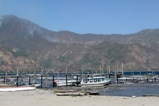 The waters of Lake Atitlán can be rough by the docks of San Pedro La Laguna where travelers catches a launch to Santiago Atitlán, Panajachel or one of the other lakeside communities.  Photo by Denise Gallinetti 2005.