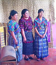 The Museo del Tejido in Antigua offers displays of traje from around the highlands. Esperanza Lopez (left) wove the huipil worn by Delmy Aramilda Sotz Lopez (right).  Aida Maritza Lopez models a new huipil, corte and belt from Chichicastenango.  Photo by Beth Riley 2005.
