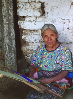 Inez Perez, a widow from the 36-year civil war, wears a huipil or blouse in a style common in San Juan Cotzal.  She wove her huipil on a back strap loom.  Photo by Paul G. Vitale 2005.