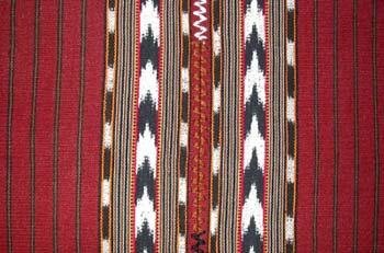 Jaspe or ikat weaving on back strap looms can be found in San Pedro La Laguna.  This tablecloth is made of two panels joined by a zigzag stitch. Photo by Kathleen Mossman Vitale 2005.