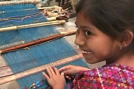 Jesica Maricruz Panjoj Lopez, 8, is already an accomplished back strap loom weaver in the style of San Lucas Tolimán.  Weavers often stick to the style of their place of birth, even if economics or marriage forces relocation.  Photo by Kathleen Mossman Vitale 2004.