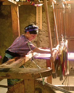 Manuela's family has a large floor loom and a small belt loom in their home on Lake Atitlán.  The large loom was originally used by Manuela's late father.  Photo by Kathleen Mossman Vitale 2005.