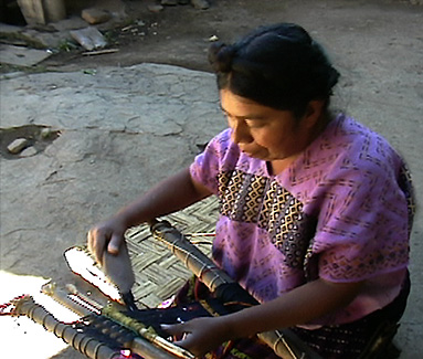 Nahualá weaver Juana Lopez straightens out the warps on her daughters weaving sample.  Photo by Kathleen Mossman Vitale 2005.