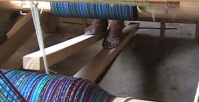 Some Maya women now use floor looms, either because young men in the family must travel far from home in search of work, or because of their own ingenuity.  The owner of this new floor loom is Sandra Lopez Perez.  Photo by Kathleen Mossman Vitale 2004.