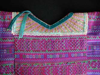 A huipil from the cooperative Estrella de Occidente store shows the heavily decorated weaving style of Todos Santos.  Collars can be purchased separately, and are reused after a huipil wears out.  Photo by Kathleen Mossman Vitale 2005.