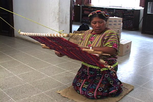 Emilia Chay Poz weaves a servilleta or multipurpose cloth on her back strap loom at the Santa Ana weaving cooperative in Zunil.  Photo by Kathleen Mossman Vitale 2005.